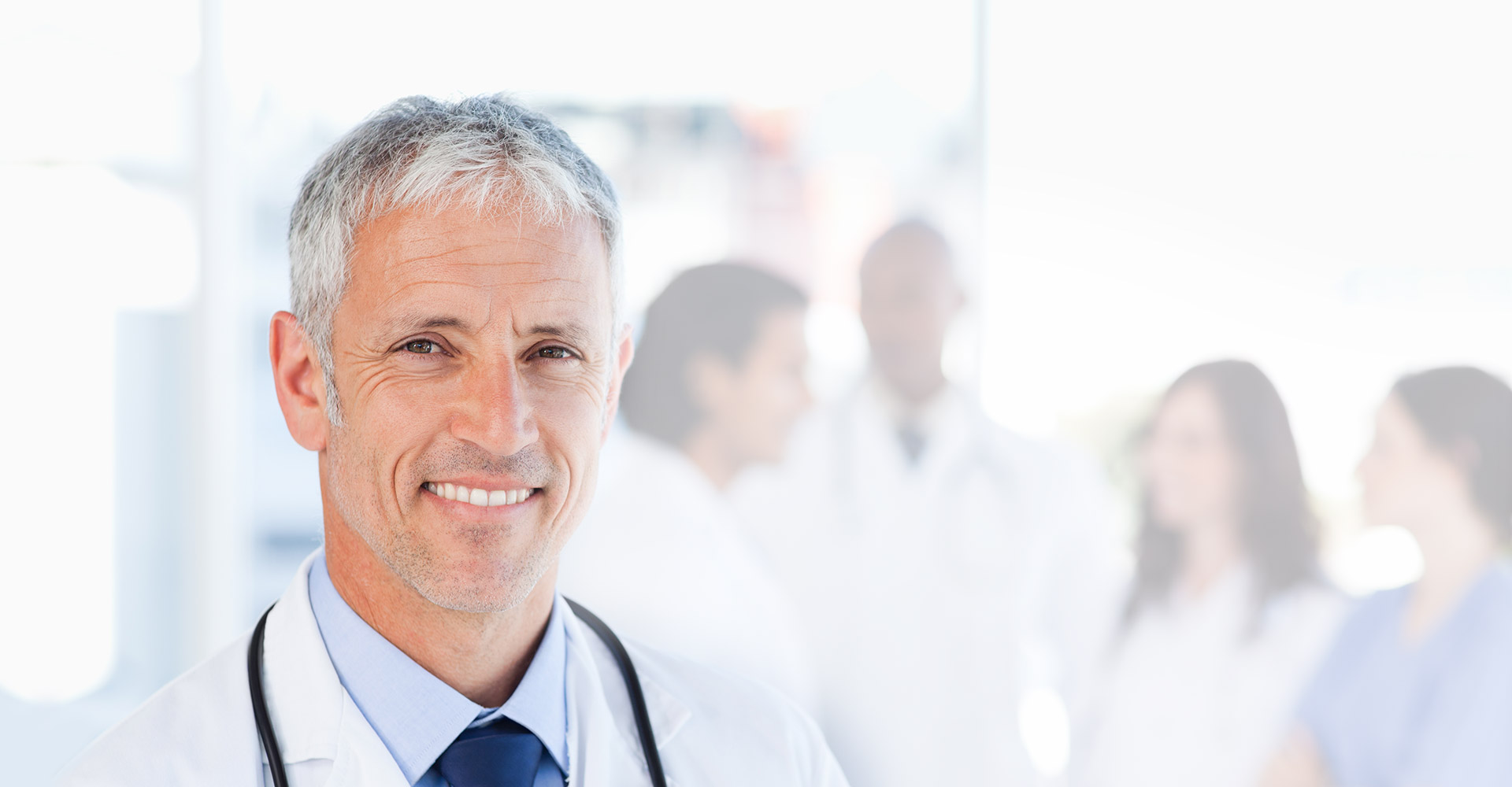 Image of doctor smiling at the camera